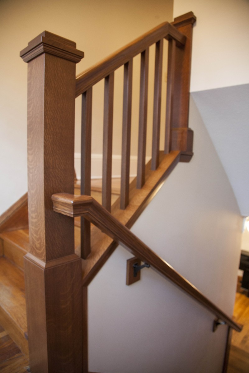 <p>The existing stairway had two major issues: the large wall limited the size of furniture the clients could bring upstairs, and the ceiling height was too low for tall members of the family. Problems were solved by raising the ceiling and opening the wall to add a finely-crafted banister.</p>