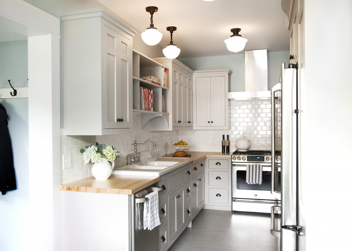 <p>This kitchen's well-crafted interior features traditional design, and custom details. The houses' original cast iron sink was saved and the cabinetry from the sixties, replaced with a style more fitting to the original 1907 home.</p>