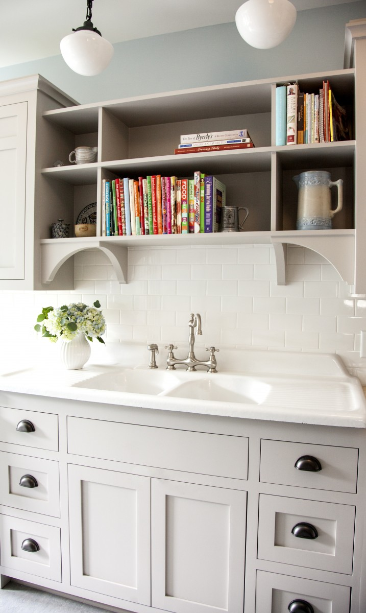 <p>The houses' original cast iron sink was saved and the cabinetry from the sixties, replaced with a style more fitting to the original 1907 home.</p>