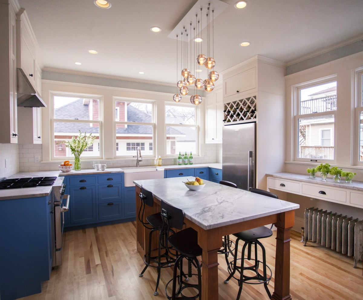 This beautiful two-story brick residence on the edge of Kenwood had a kitchen that had been poorly re-done mid-20th century, and needed to be brought up to the quality of the rest of the original home. All new finishes, cabinetry and additional windows transform the space entirely. Granitecountertops and a farmhouse sink center on new windows that look out to a yard and traditional garage at the back of the house.