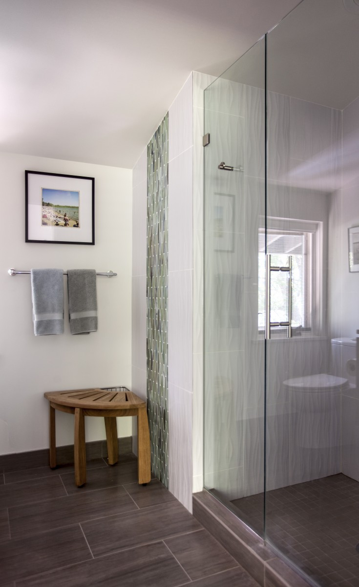 <p>The fixtures in this master bath were rearranged to create space for the shower that was lacking from the original.  A blend of textured and glass tile drew inspiration from nature and was used to bring a subtle touch of organic form and color to the space.</p>