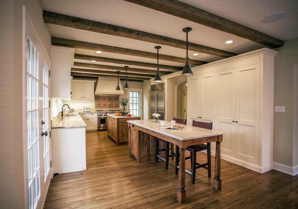 <p>A 1980's kitchen area at the back of this Mediterranean style home was poorly organized and needed to be re-built to fit the style of the house. Wood timbers, traditional fittings and hand-made tile accents achieved this goal.</p>