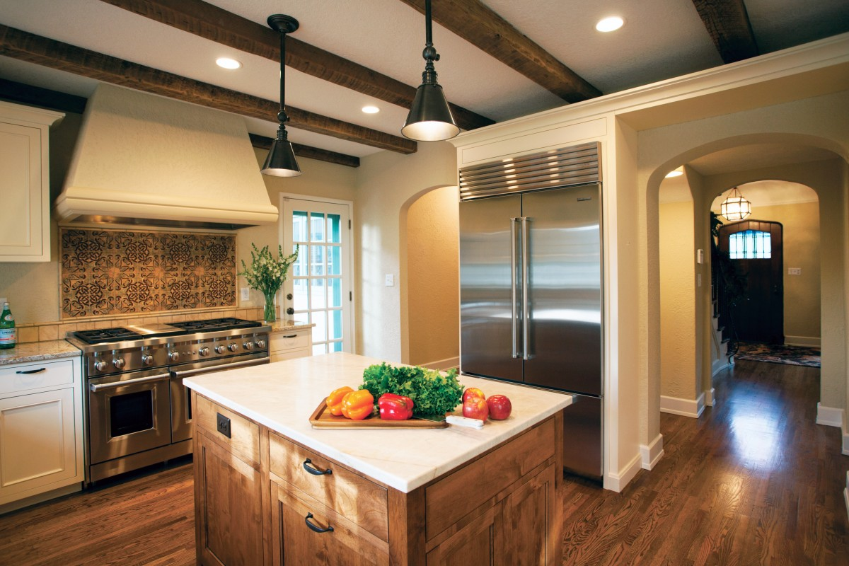 <p>New appliances and improved lighting, along with an island devoted specifically to the cook's needs make this a kitchen that is a joy to work in.</p>