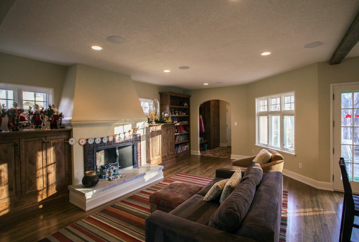 <p>The fireplace and mudroom were remodeled to fit with the home's restored mediterranean aesthetic.</p>