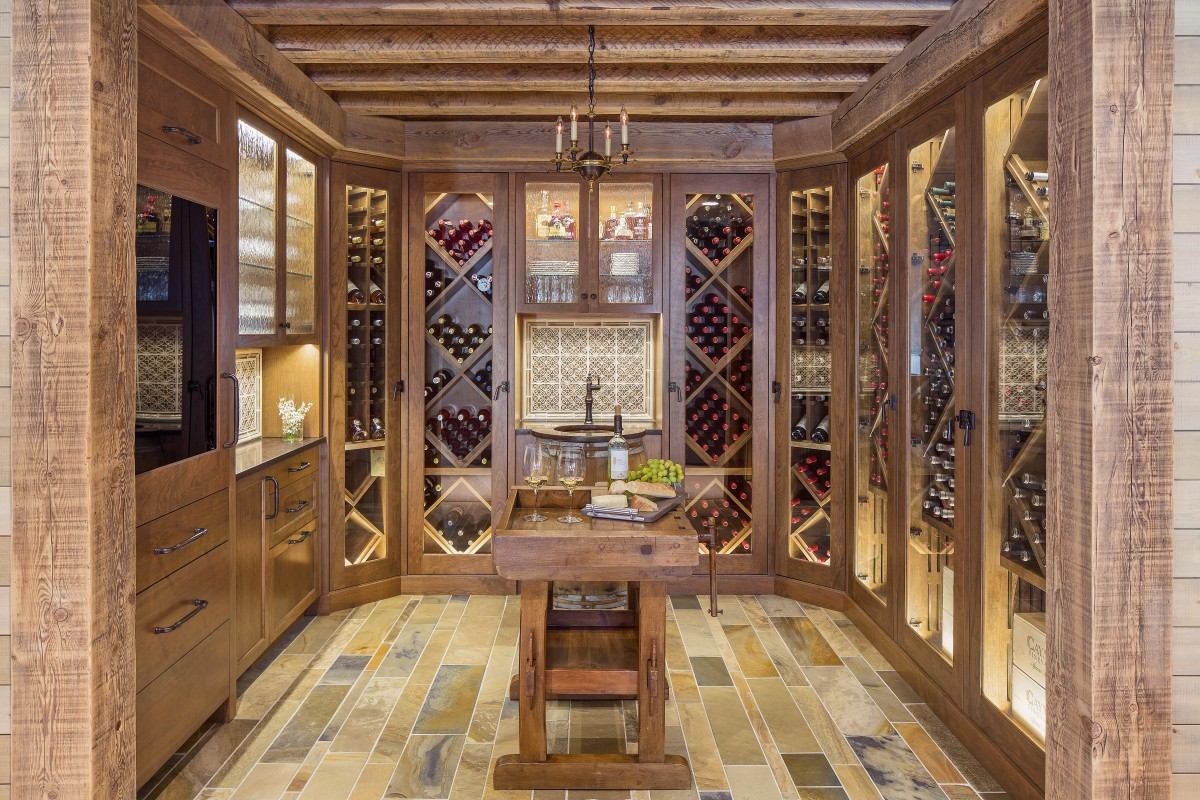 The wine room is open to the rest of the basement and its cabinets hold approximately 750 bottles. Its appliances and a modest sink are built-in to keep the wine as the focal point of the room. Temperature, air movement, and humidity are carefully controlled within the cabinets.