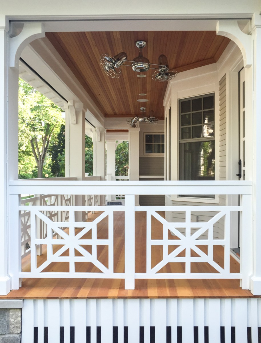 The new Craftsman style porch is equipped with motorized retractable screens creating an outdoor space that is either completely open or bug-free, at the push of a button.