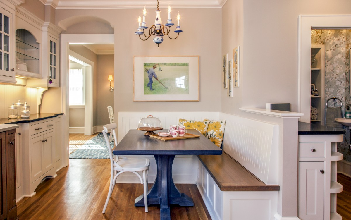 <p>An L-shaped booth creates room for the whole family or entertaining. A beautiful powder room off the kitchen and living room adds to the charm of the home.</p>