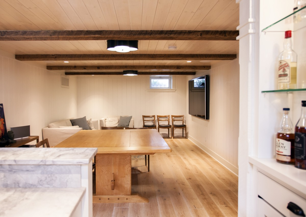 The basement was detailed in Swedish Stuga style with reclaimed ceiling beams