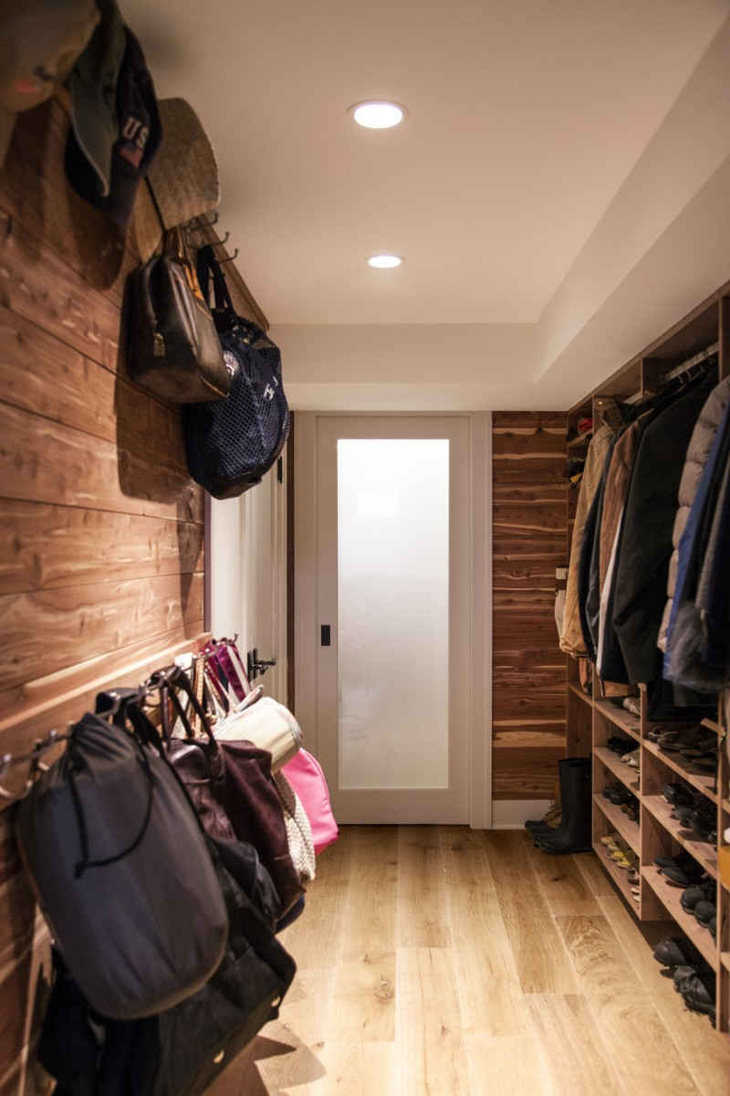 A custom basement storage closet was built with 5″ eastern red cedar tongue-and-groove horizontal paneling.