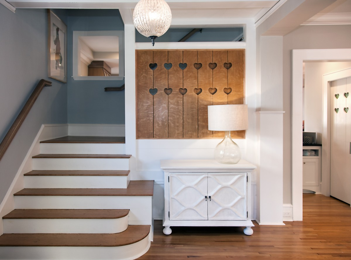 <p>The oak floors throughout the main floor were refinished to allow the space to blend in with the rest of the remodel. The heart motif from the front baluster was used in several other places in the home.</p>