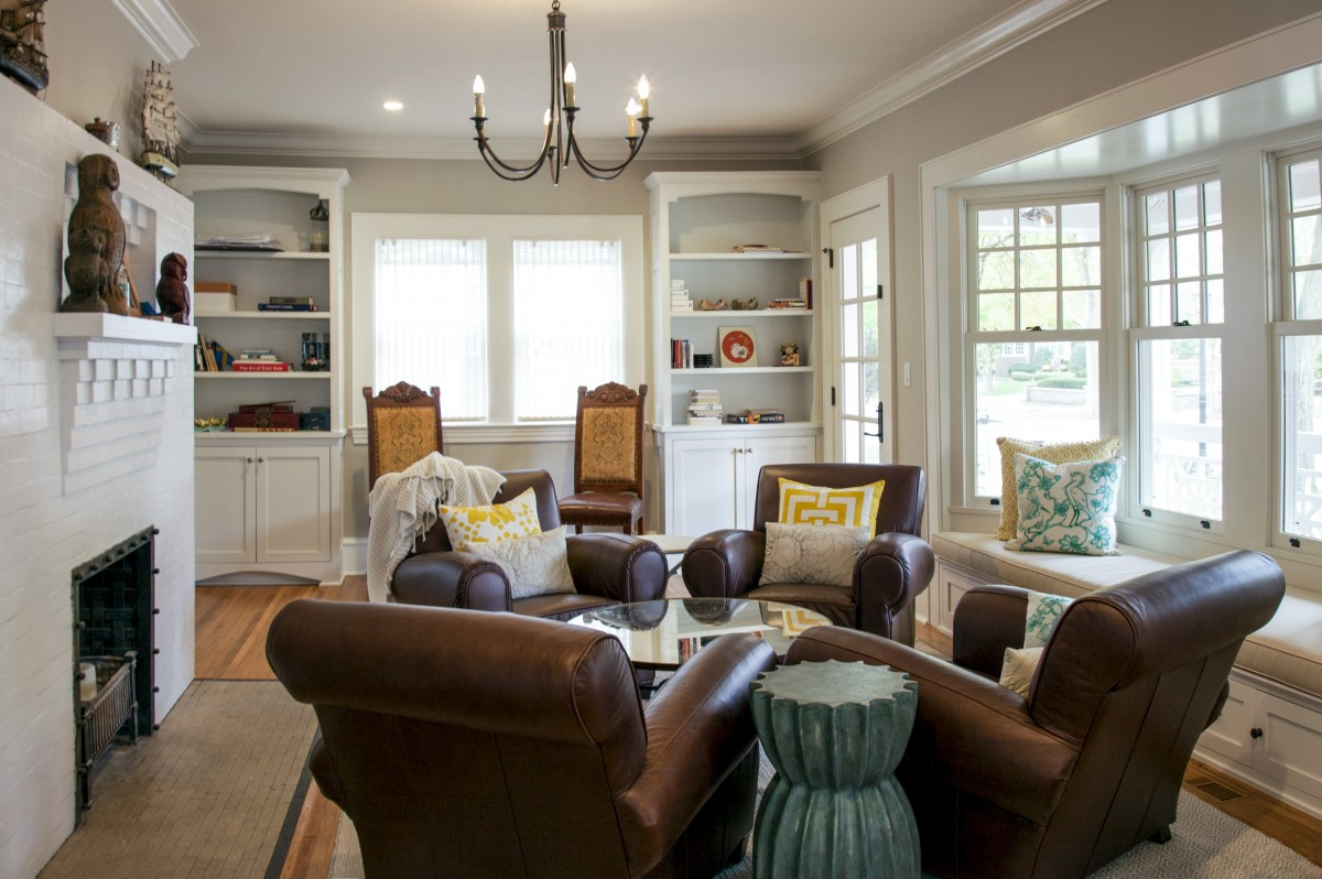 The main-floor living room was reconstructed with a bay window and french doors. New built-in bookshelves create storage.