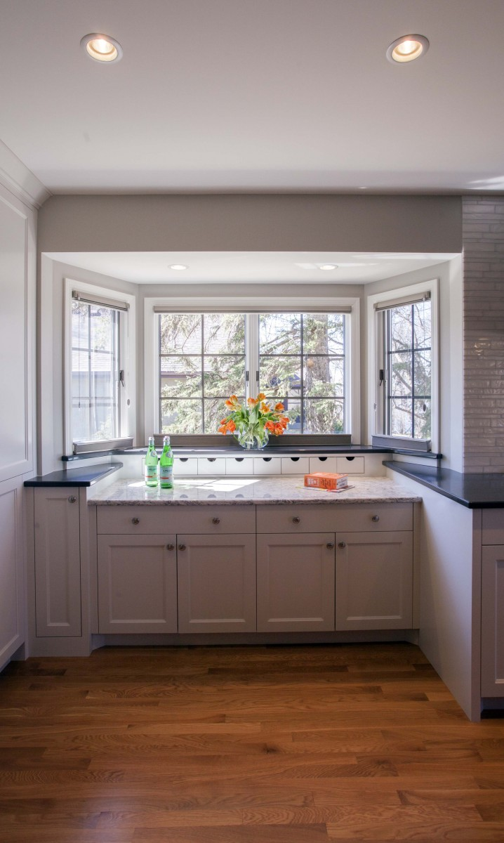 <p>An existing bay window was utilized to create a baking center adjacent to the wall ovens. A dropped counter makes rolling dough easier &amp; bin drawers create easy access to sugars, spice and everything nice.</p>