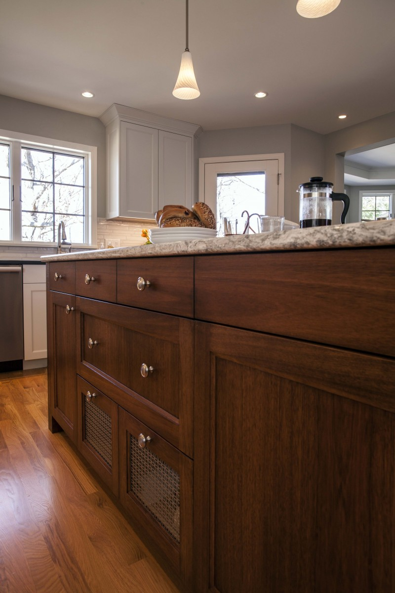 <p>Stained Eucalyptus wood was used on the island to compliment existing rosewood furniture pieces. Stamped metal screens provide ventilation for vegetable drawers conveniently located next to the prep sink.</p>