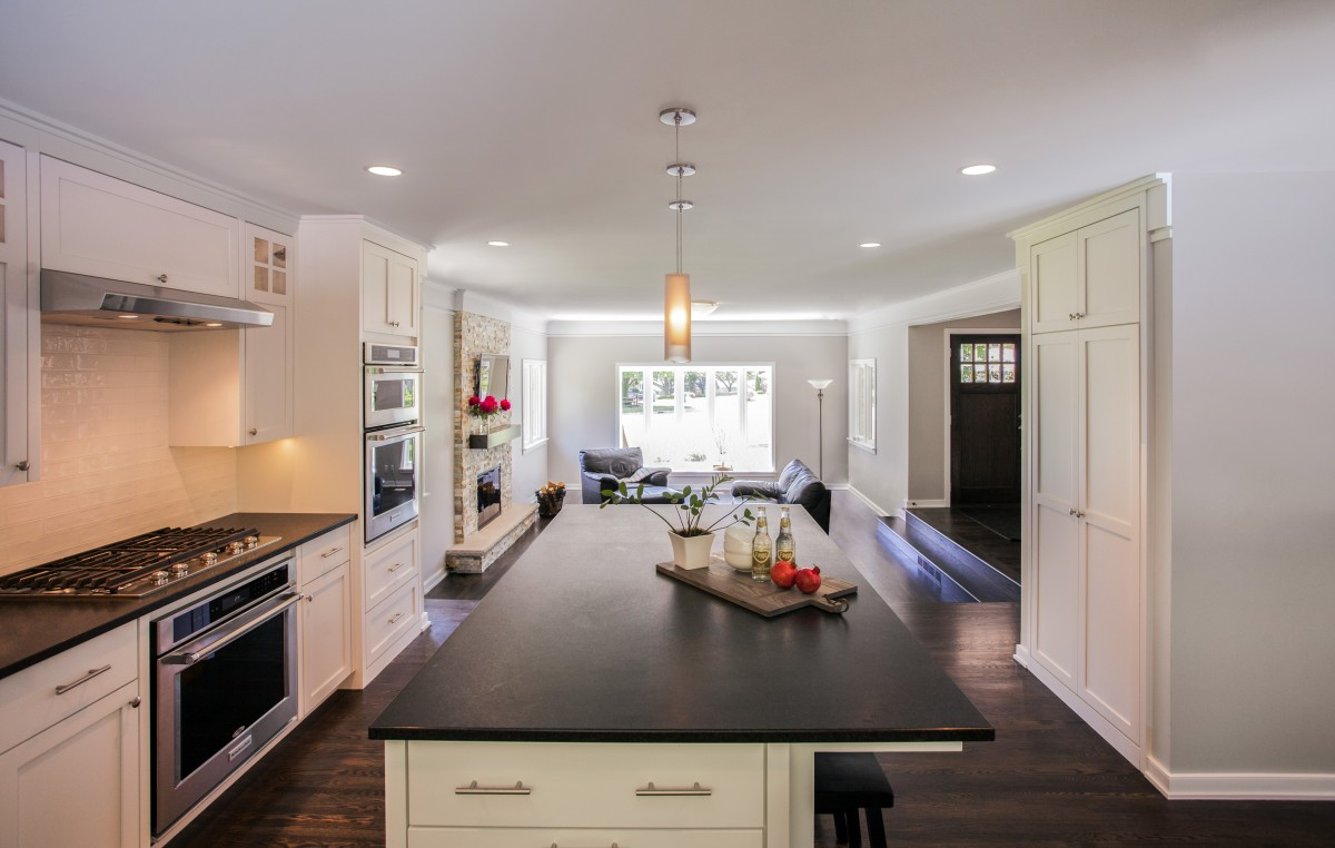 This well-crafted main floor interior features traditional design, stylish clean lines and custom details. The new spaciouslayout was enhanced by remodeling the kitchen and opening it up to the new family room.