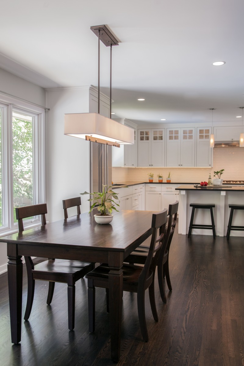 <p>Thekitchen was relocatedto create a larger space forboth cooking anddining. Unique light fixtures and neutral color palettes create asofter, more relaxed feel.</p>