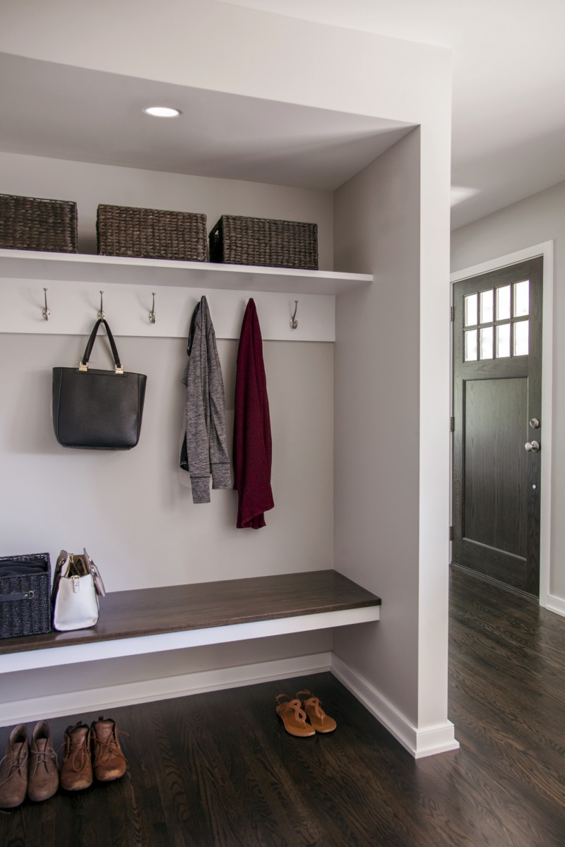 A built-in bench and multiple closets were added to create a mudroom and additional storage space.