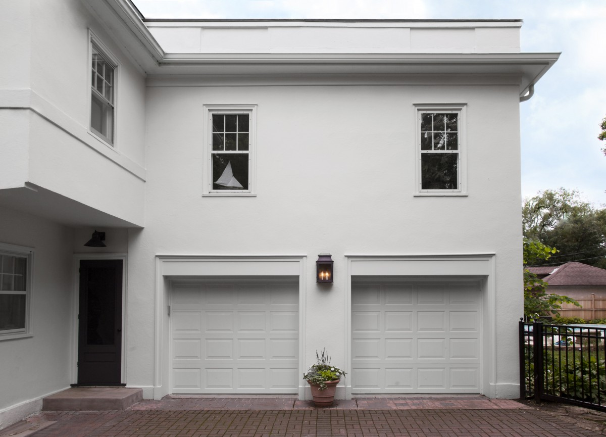 The garage's applied decorations and beltline were removed and wider garage doors were installed.