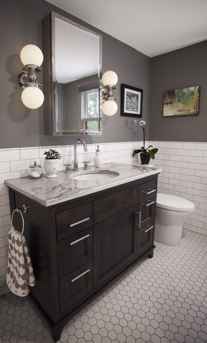 <p>An undermount sink, a furniture-like vanity, granite countertops, and interesting finishing materials were key to helping this transitional bathroom project stand out.</p>