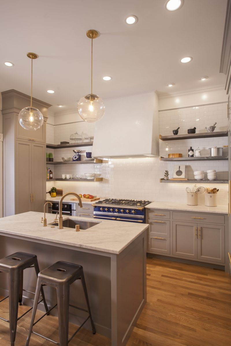 The inspiration for the design of this kitchen and dining room came from the owners' desire to have a stylish kitchen with some modern touches while staying true to the character of their historic and highly-detailed 1890's home.
