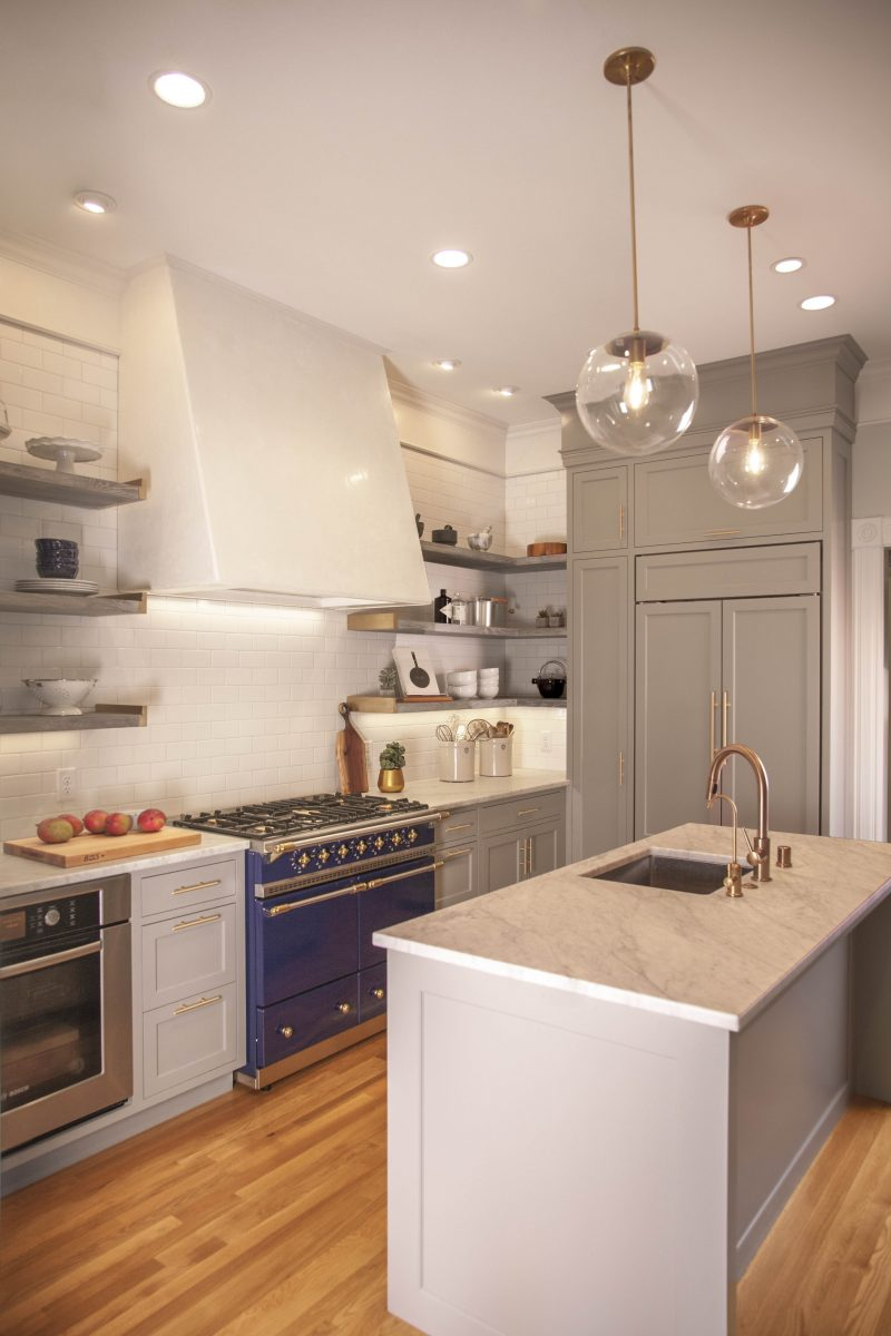 <p>Open cerused oak shelving and white subway tiles give the kitchen an open feel, while a handmade venetian plaster hood and custom brass shelf ends add an old-world feel to the space and accentuate the superb Lacanche stove.</p>