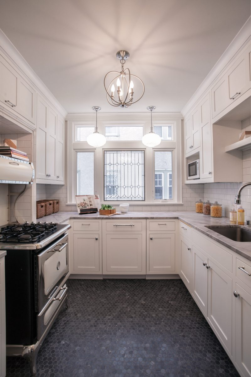 "<p>The owner of this unique duplex remodel wanted to bring back the historic character of the Minneapolis home. While the original kitchen was similar in layout, it lacked counter space, light and storage. Large white cabinets, additional windows and ""super white""granite countertops allow for the compact space to be used to its full potential.</p>"