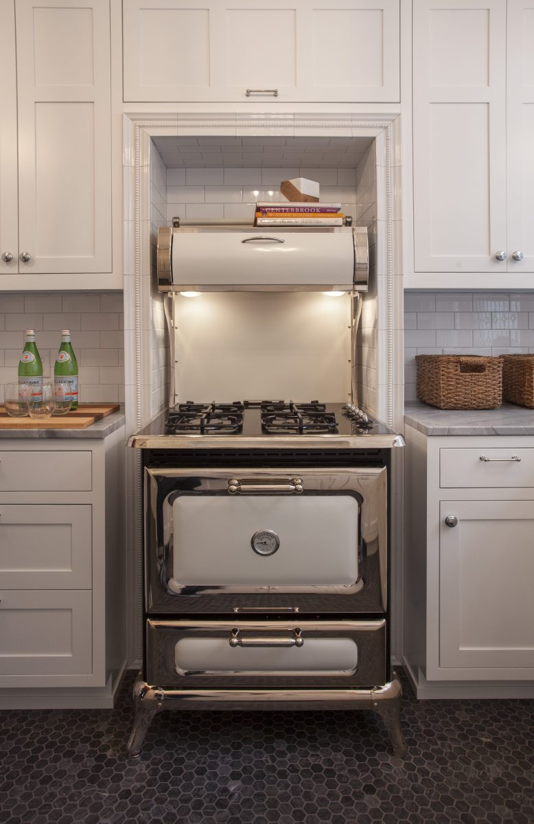 <p>This Heartland stove, which was designed to look like a wood burning stove, became an inspiration and focal point of the kitchen.</p>