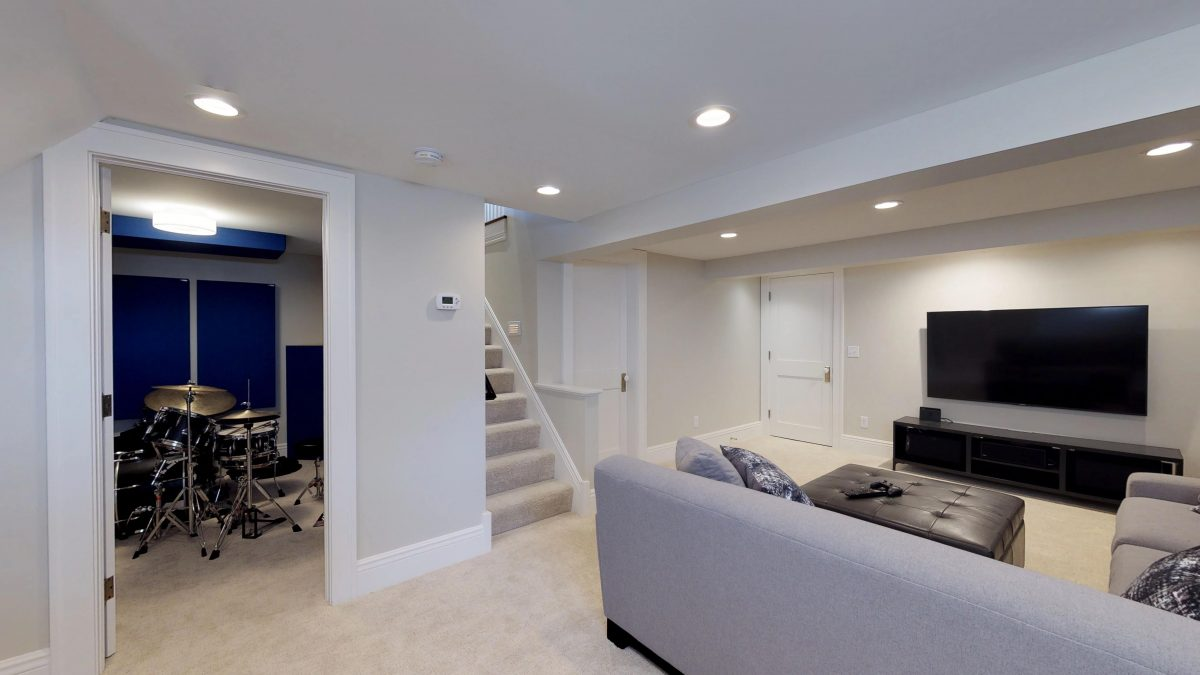 The finished basement is now a beautiful space featuring a laundry room, music studio, and a large open area for play and entertainment.
