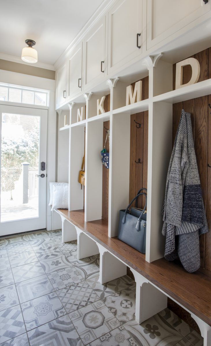 <p>Added cabinetry for each of the family members and created areas above for added storage.<br /> Patterned porcelain tiles were selected to add warmth and a traditional touch that blended well with the wood floor.</p>
