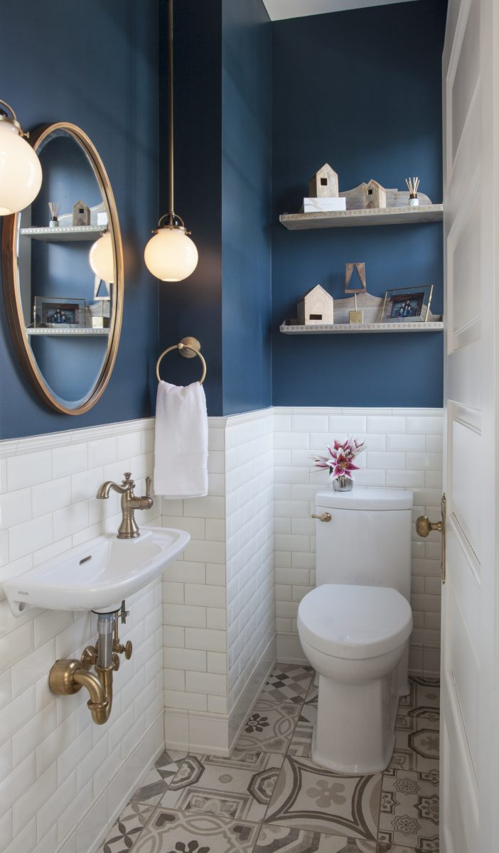 <p>A beveled wainscot tile base, chair rail tile, brass hardware/plumbing, and a contrasting blue, embellish the new powder room.</p>