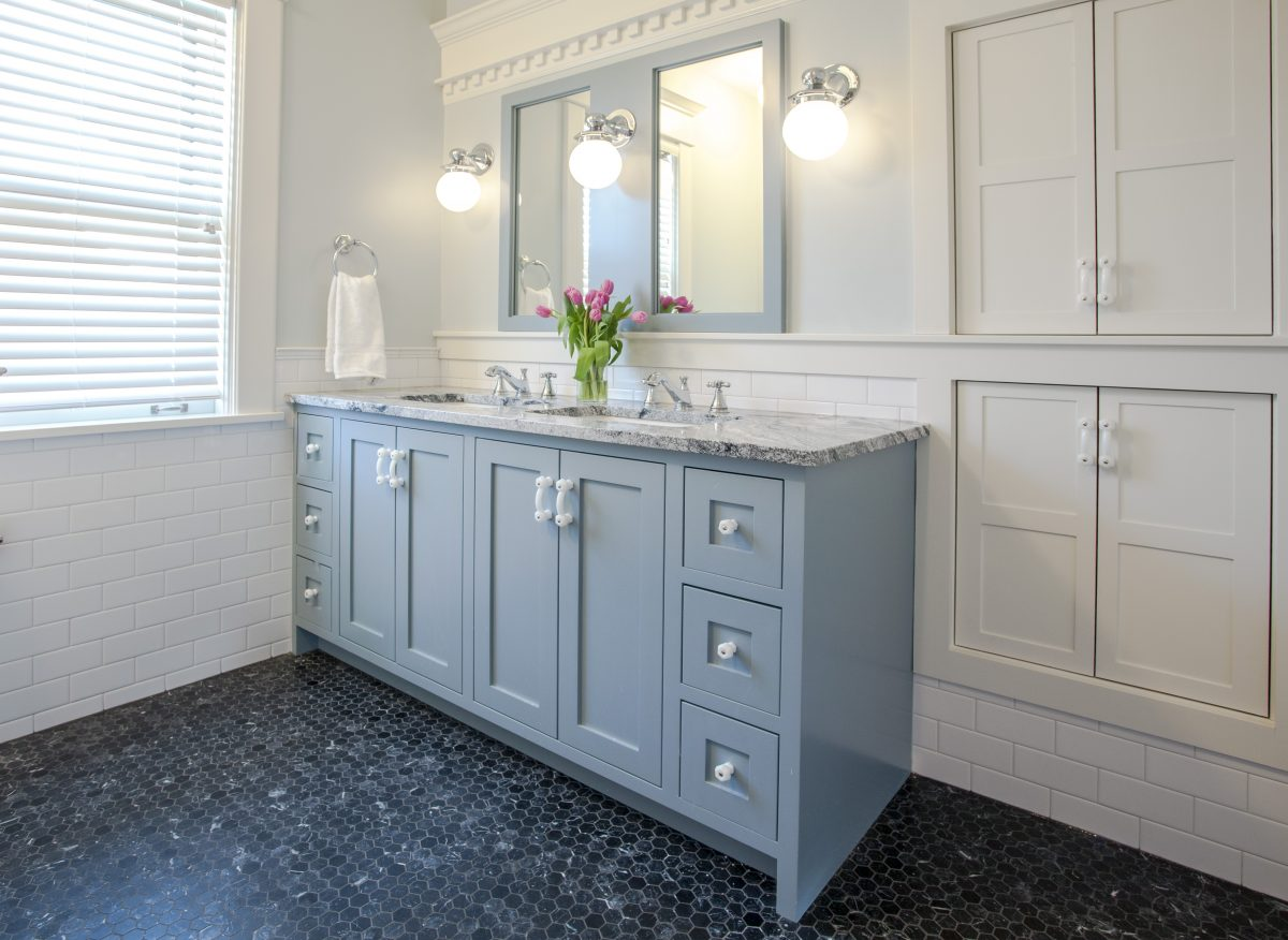 <p>The layout in the second-floor bathroom was changed to better accommodate the toilet, tub, and shower. A new vanity was added for more storage and kid delineated space. The crown trim along the vanity wall was part of the existing built in.</p>