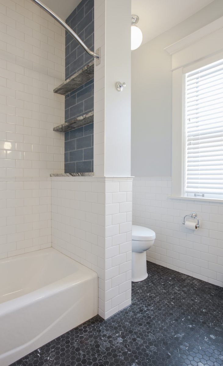 <p>A Maiolica tiled niche wall in between the bath and toilet was added for shower storage.</p>