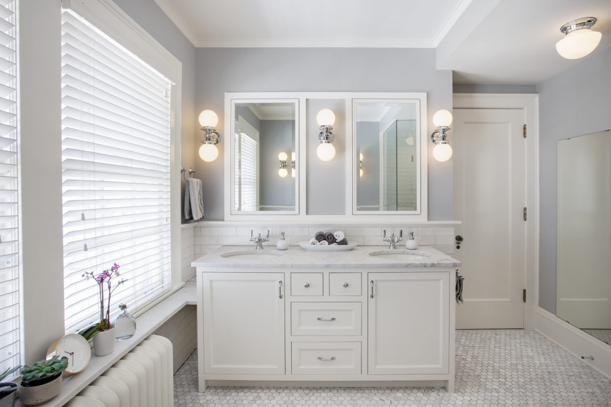 <p>A serene space cloaked in aCarrera marble tile, this master bathretreat finds it's sophistication in simplicity. To give this remodeled bath its look of soothing elegance, we played with cool tones of white and blue against the rich textures of the floor and black accents.</p>