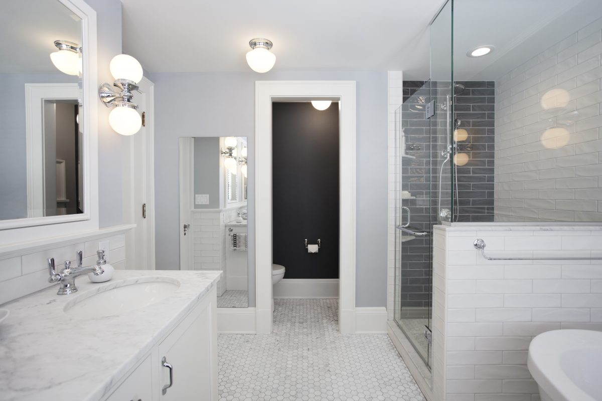 <p>Bringing a pop of black into space created a more livable feel in this master suite. The new design provided the natural light the homeownerswanted along with a semi-private toilet and direct access to the laundry chute.</p>