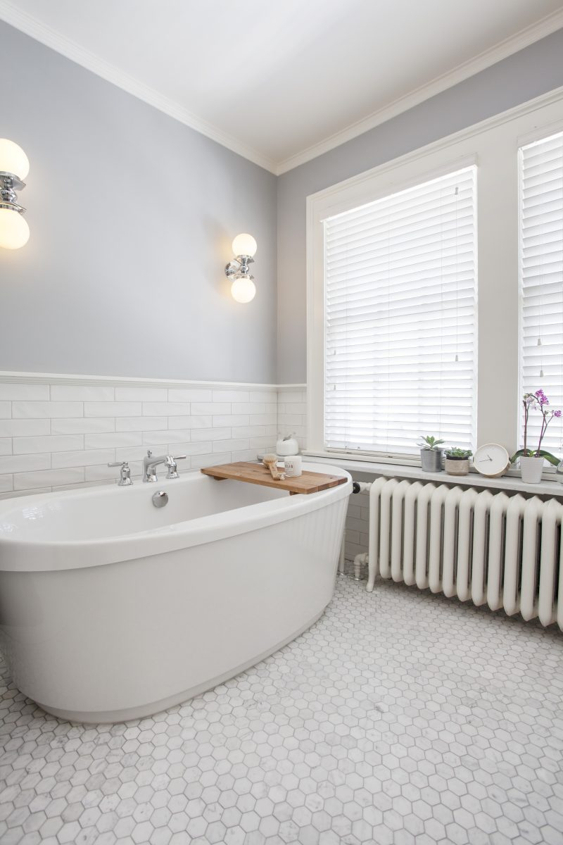 <p>The freestanding tub in this beautiful master bath is as sculptural as it is inviting.Classic Carrara marble hex tile on the floor of the master (a nod to traditional) and a less expensive subway tile create a sense of handmade texture.</p>