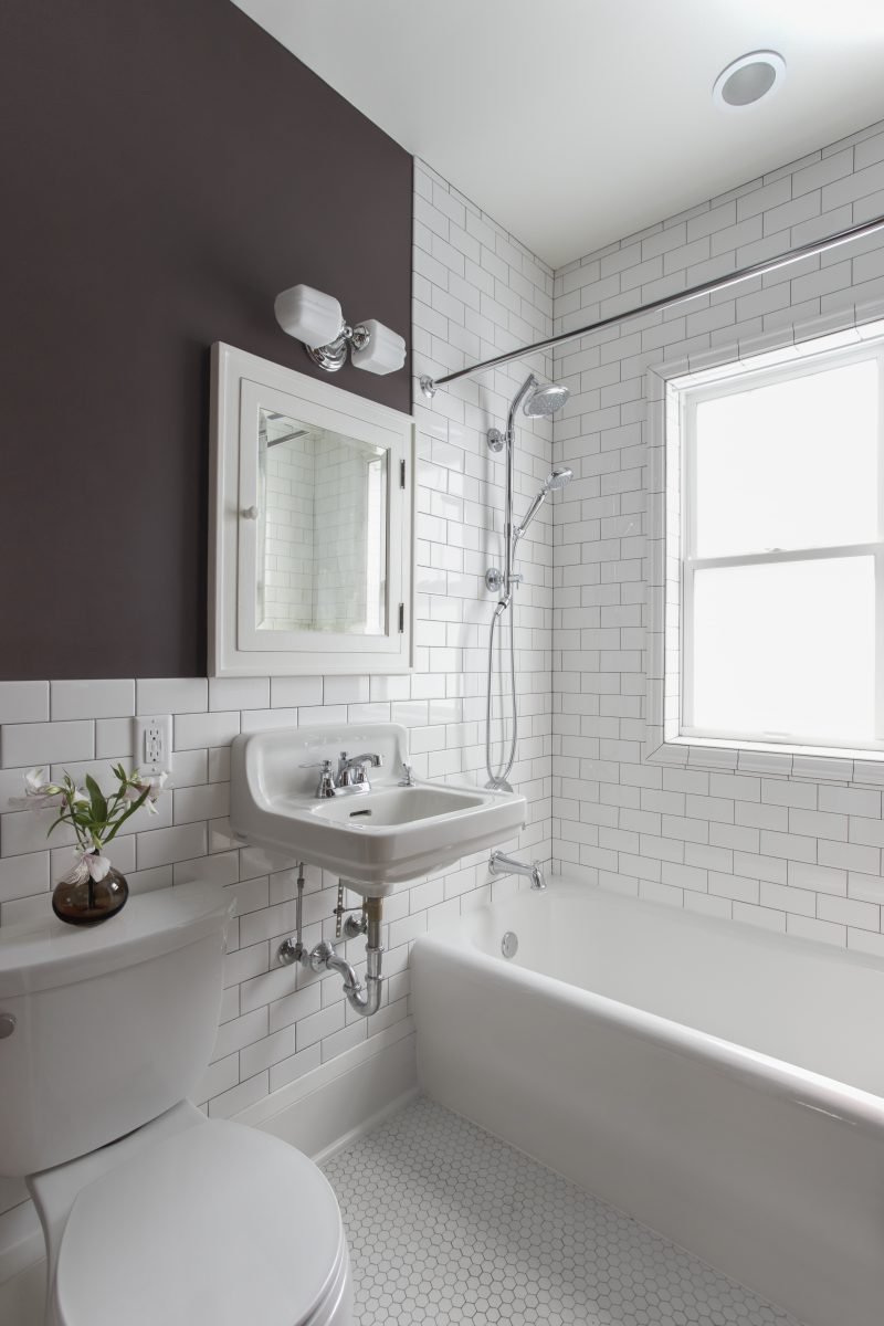 The clients found a vintage wall mounted sink and medicine cabinet to help embody the history of their home. Along the same lines, the original marble hex tile floor and bathtub were refinished instead of replaced. A window was added in the shower to make the space seem bigger and brighter.