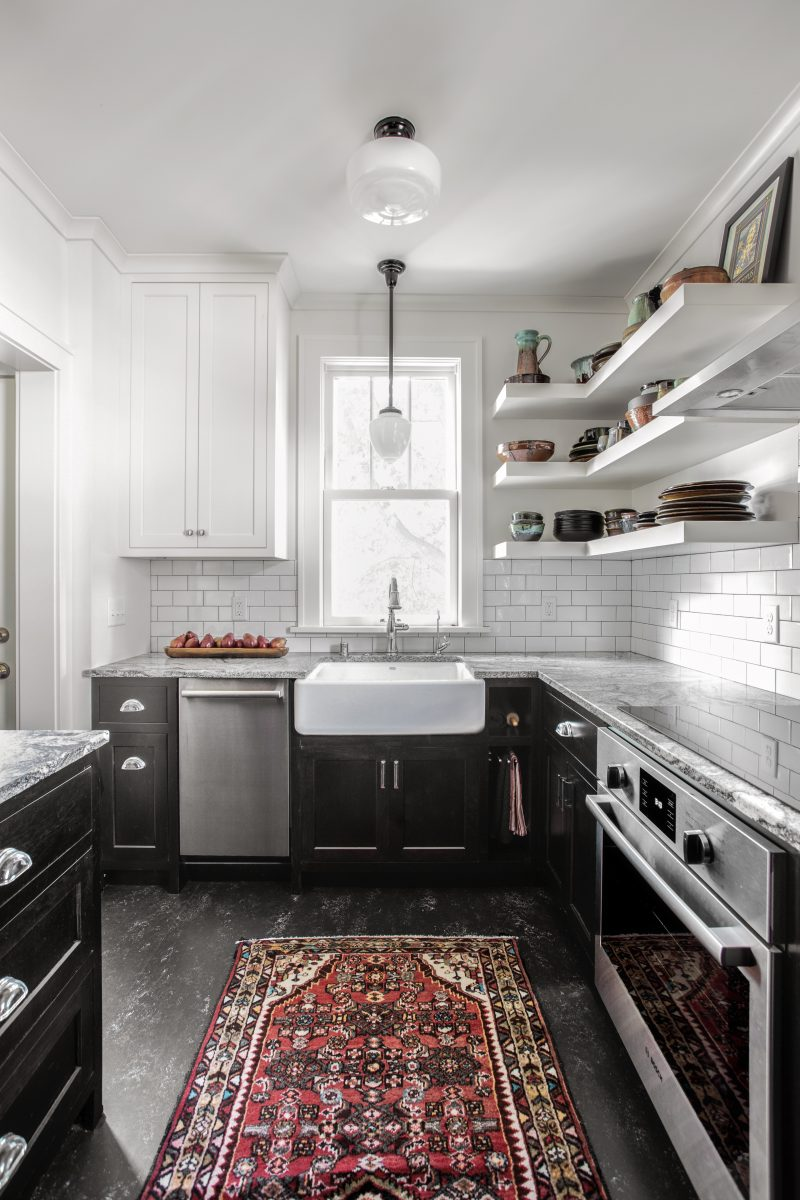 The clients were involved in the neighborhood organization dedicated to keeping the housing instead of tearing down. They wanted to utilize every inch of storage which resulted in floor-to-ceiling cabinetry. Cabinetry and counter space work together to create a balance between function and style.