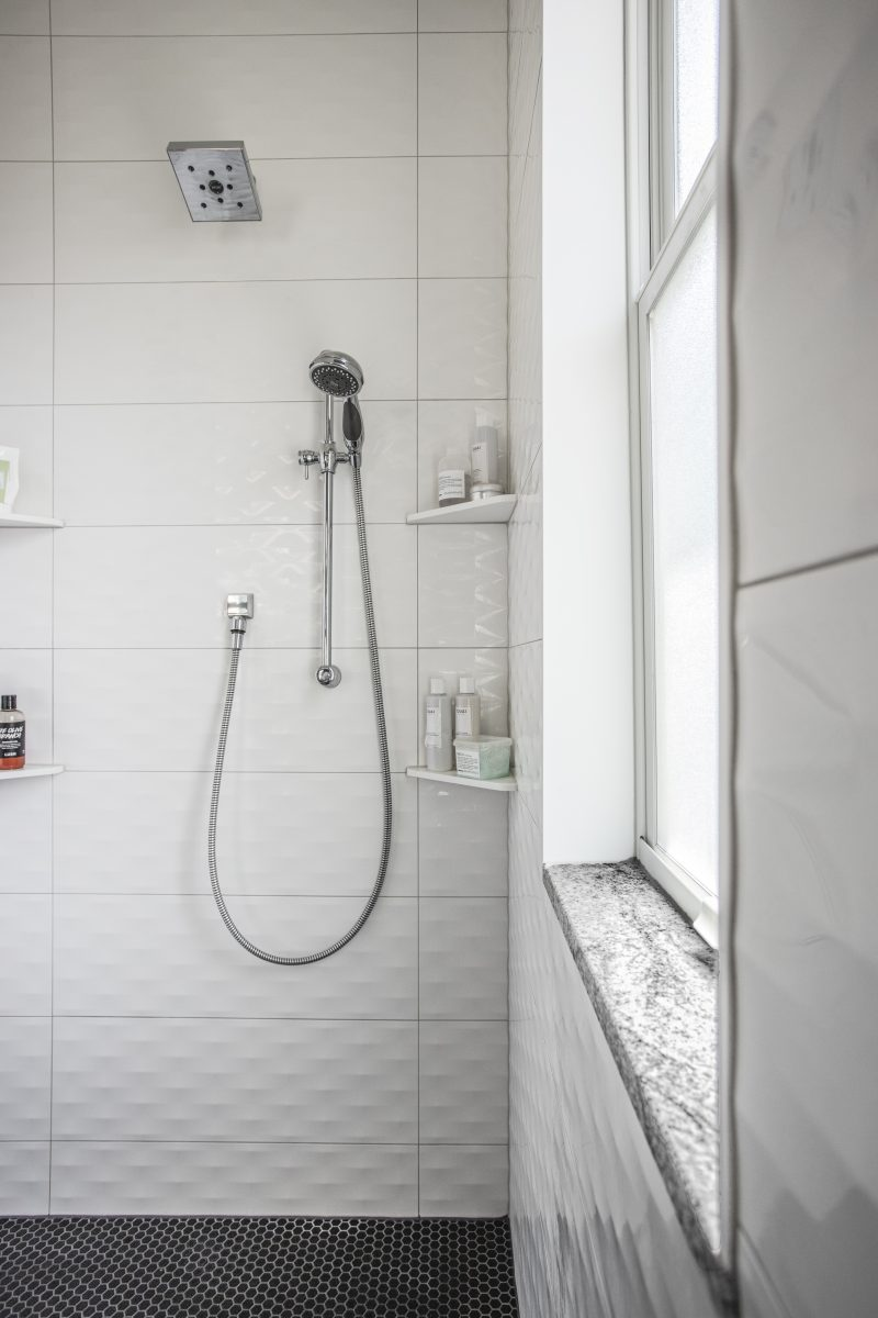 Textured contemporary wall tile adds pattern and creates an elegant look in the walk-in shower.