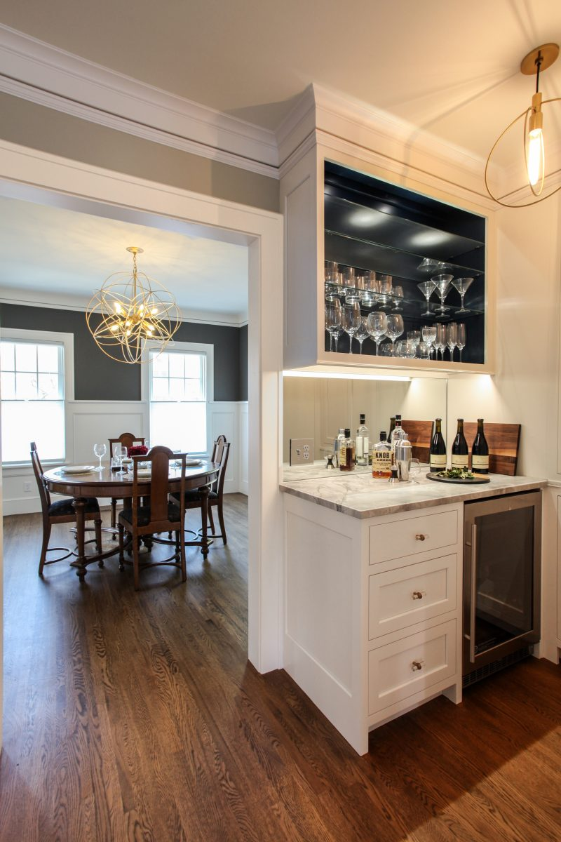 "<p>The owners wanted a bar to allow the mixologist in the family a space to prepare cocktails with homemade bitters. The lights and hardware connected the contemporary shape of the dining room chandelier and the globes in the kitchen.</p> <p><iframe src=""https://my.matterport.com/show/?m=QZAzja3mfVH&amp;brand=0"" width=""853"" height=""480"" frameborder=""0"" allowfullscreen=""allowfullscreen""></iframe></p>"