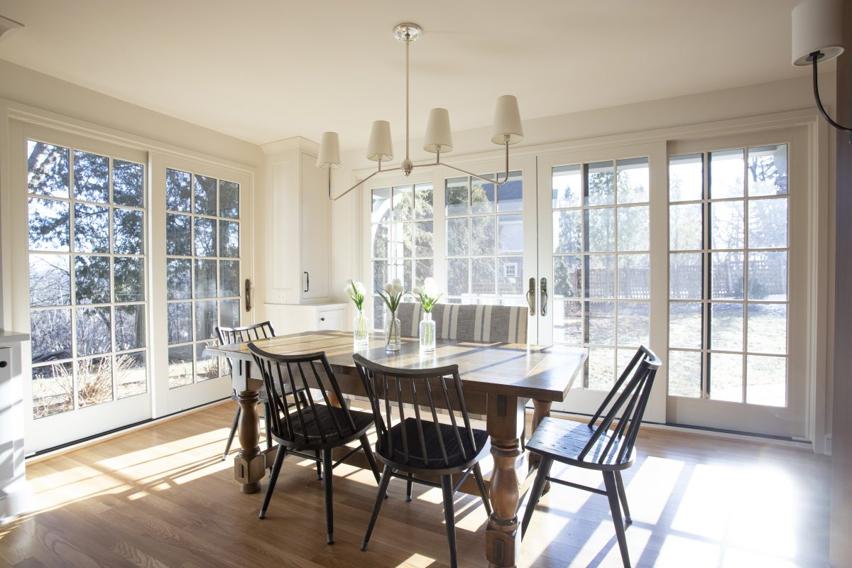 The dividing wall of cabinets between the kitchen and breakfast room was removed and the bay window was replaced with a large sliding french door and canopy, creating a stronger connection between the rooms and the yard and views beyond.