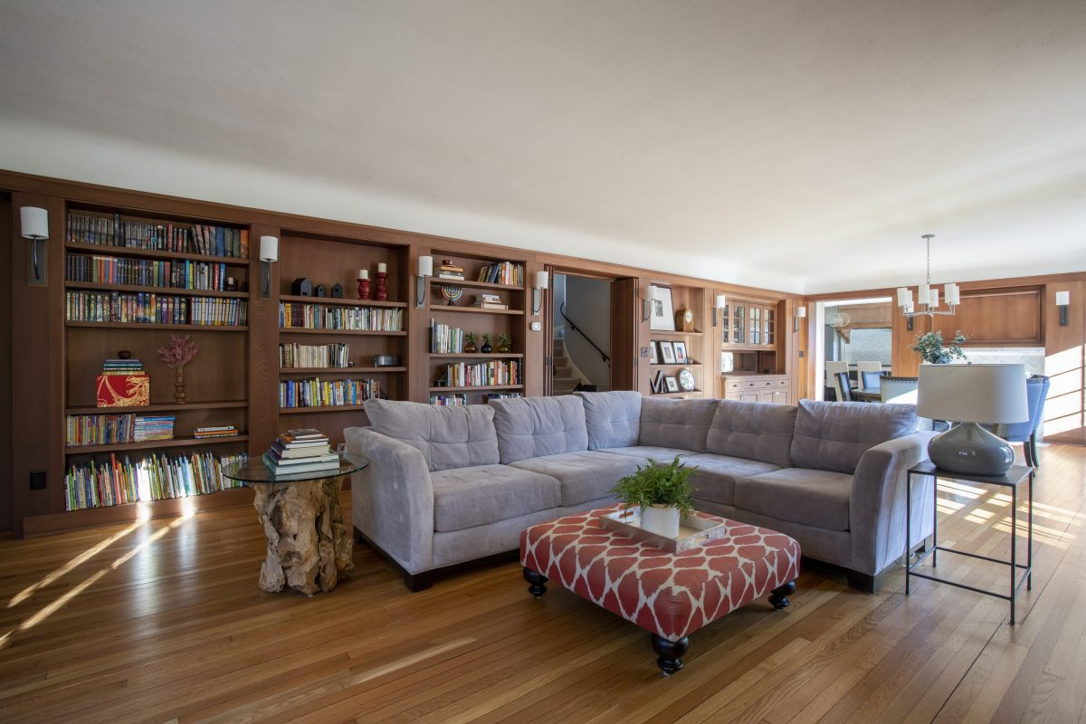 Dated cabinets from the 80's were replaced with simple bookshelves using salvaged paneling removed to accommodate the new buffet, providing a home for the owner's book collection.