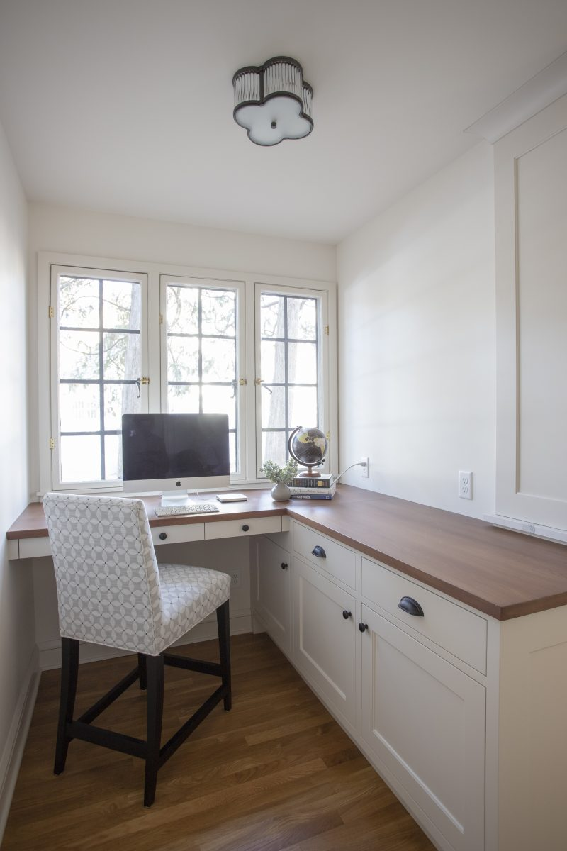 An un-used nook received new cabinets and counter creating and overflow prep area for caterers when entertaining while doubling as a small office area and room for the family dog.
