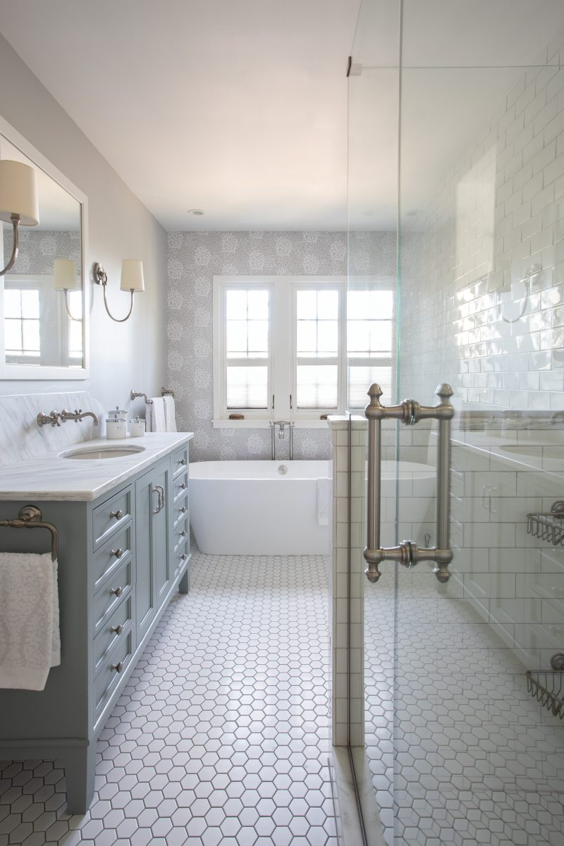 Creating space for a bathtub was the top priority for the homeowners. A superfluous vestibule was removed, making room for a beautiful pedestal tub.