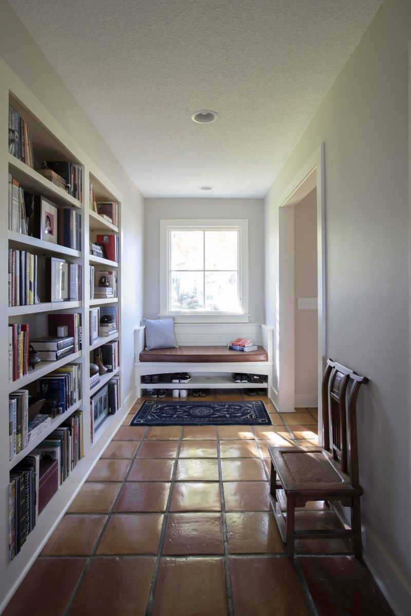 <p>A dedicated, and gracious entry creates a welcoming space with room for a cherished antique furniture piece and bookcase in the hallway.</p>