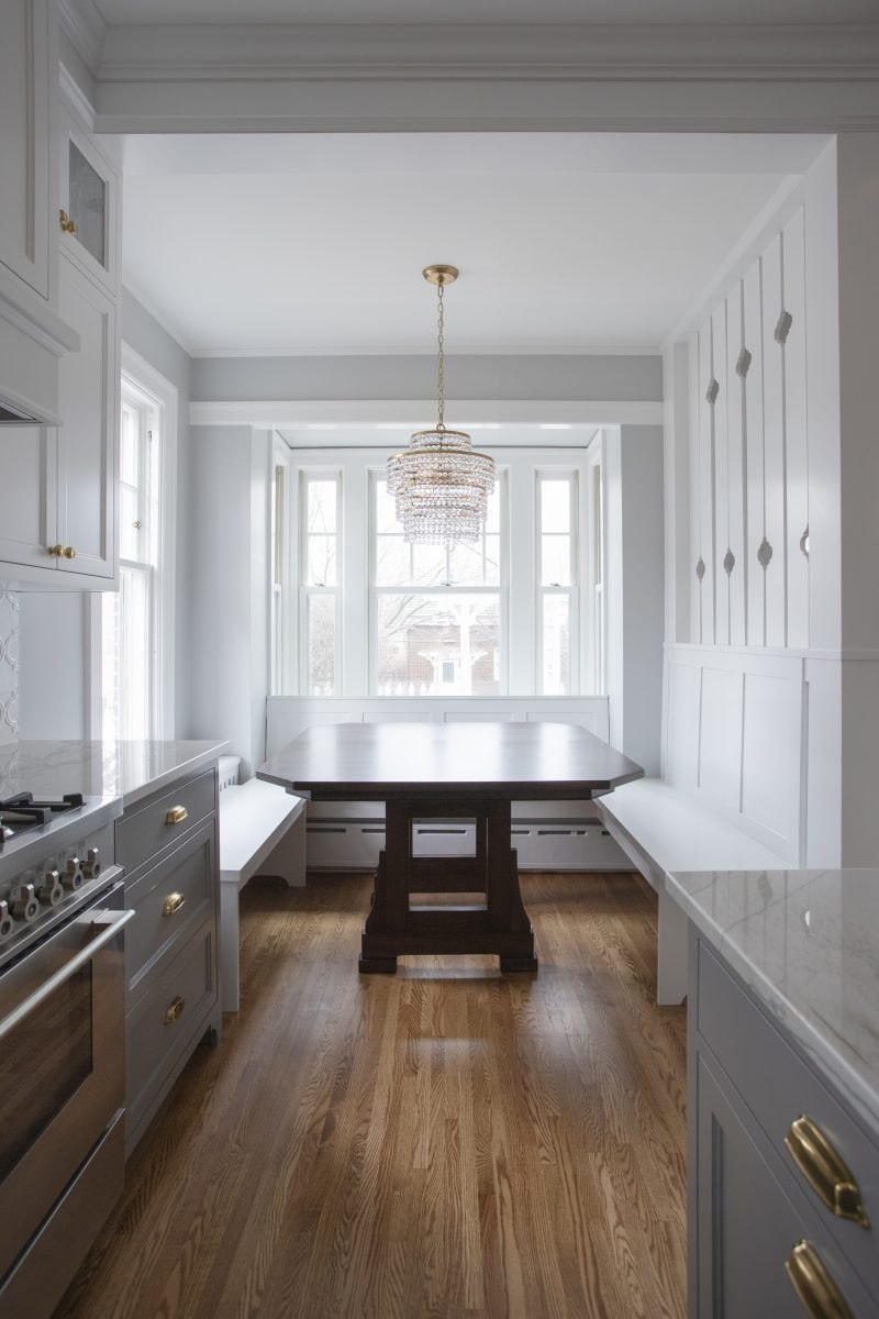 <p>Materials such as soft touched of brushed brass intermingled with other brass touches in the home the tile and custom cutouts between the breakfast nook and rear stairs mimicked other arabesque shaped details throughout the home.  Light airy colors also helped open and brighten up the space.</p>