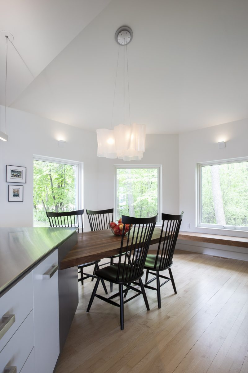 <p>The north-facing kitchen went from a fairly dark space to a bright room that feels integral to the house. The large windows allow for beautiful views of the lake and the forest while bringing in plenty of natural light.</p>