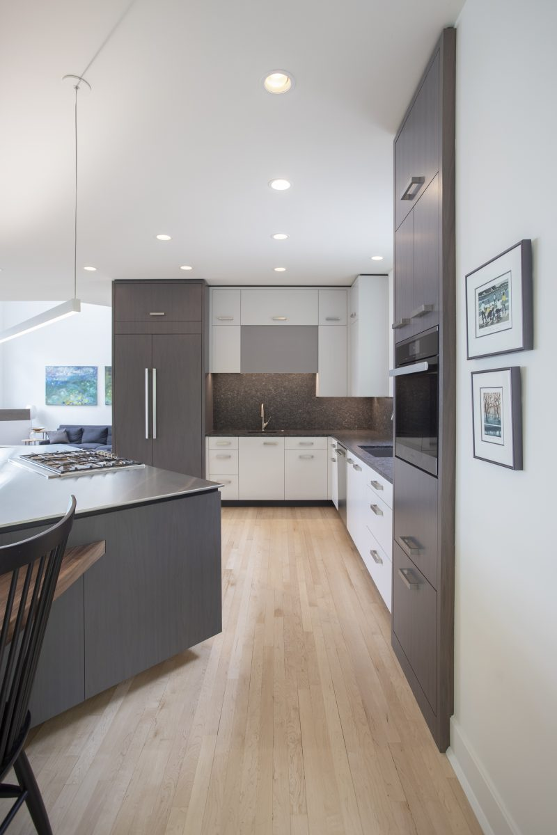 <p>The homeowners wanted to keep the maple and walnut floors and incorporate it into the expanded kitchen. The stained walnut was used to blend the oiled walnut and the tones from the maple floor.</p>