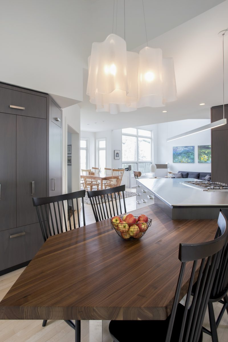 <p>The space was designed so that the two separate areas were combined into one spacious kitchen that pulled the lake closer by emphasizing the views. The gracious work area now allows more people to gather in the kitchen yets keeps it highly functional for the two homeowners.</p>
