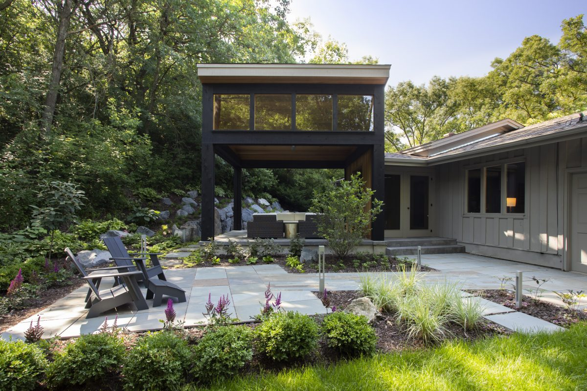 <p>The owners wanted to ensure that the design of the addition emphasized the beautiful forest surrounding the home. Dark beams mimic the trees, and the cedar wood interior embodies earth tones creating a space that truly embodies modern indoor-outdoor living.</p>